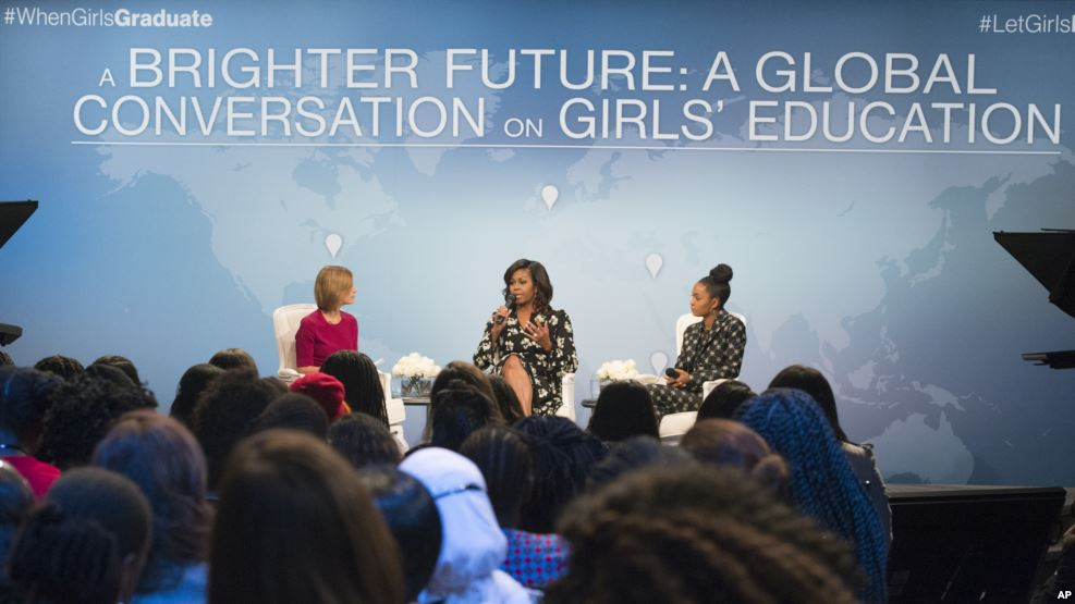 """First lady Michelle Obama, flanked by actress Yara Shahidi (R) and Glamour Magazine Editor in Chief Cindi Leive, participates in Glamour's """"A Brighter Future: A Global Conversation on Girls' Education,"""" in celebration of International Day of the Girl and Let Girls Learn, Oct. 11, 2016, at the Newseum in Washington.(VOA Credit)"""