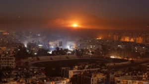 Smoke and flames rise after air strikes on rebel-controlled besieged area of Aleppo, as seen from a government-held side, in Syria December 11, 2016.Share