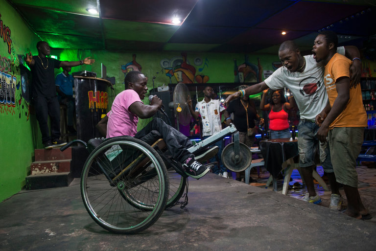 Emmanuel Dongo, a Liberian rapper known as Lyrical D, performing last month at the Code 146 nightclub in Monrovia. Credit Jim Tuttle for The New York Times