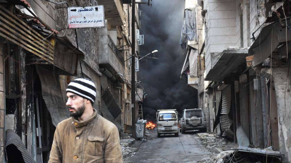 A Syrian man walks through the former rebel-held Salaheddin district in the northern Syrian city of Aleppo, Dec. 23, 2016. (PHOTO CREDIT: VOA)