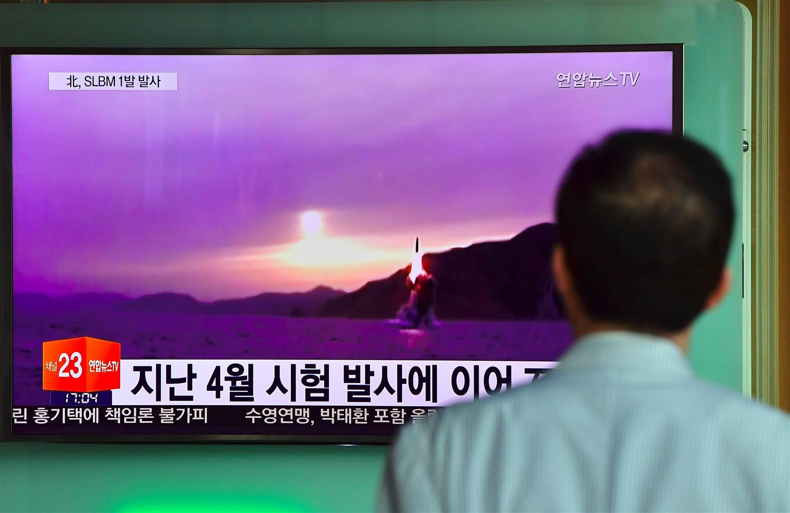 A man watches television news broadcast showing file footage of a North Korean missile launch at a railway station in Seoul, South Korea, on Saturday. JUNG YEON-JE / AFP - Getty Images