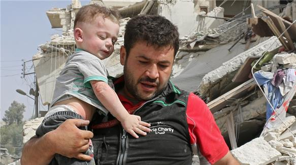 A man carries a baby after an air strike in a rebel-held area of Aleppo on Wednesday [AFP]A man carries a baby after an air strike in a rebel-held area of Aleppo on Wednesday [AFP]