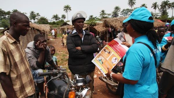A UNICEF worker speaks with drivers of motorcycle taxis about the symptoms of Ebola virus disease (EVD) and best practices to help prevent its spread, in the city of Voinjama, in Lofa County, Liberia. (Photo: Reuters)