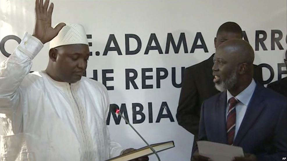 Adama Barrow, left, is sworn in as President of Gambia at Gambia's embassy in Dakar Senegal in this image taken from TV Thursday, Jan 19, 2017.