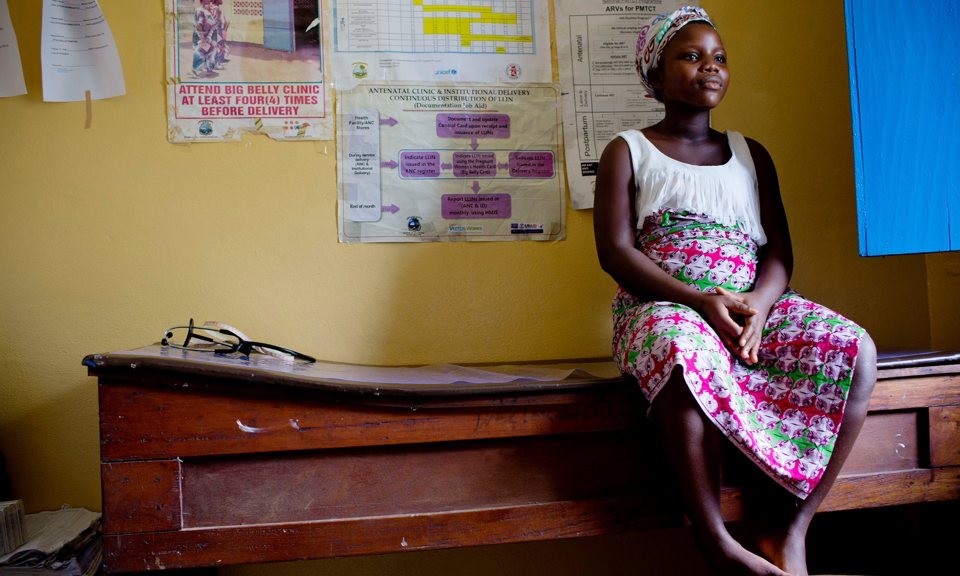 Maria, 17, who is pregnant with her second child, waits to be examined at the Well Baby clinic in Buchanan, Liberia. All photographs by Kate Holt