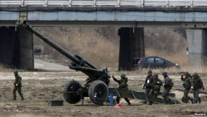 FILE - South Korean soldiers of an artillery unit take part in an artillery drill with 155mm Towed Howitzers in a previous year's Foal Eagle joint military exercise of the U.S. and South Korea, near the demilitarized zone (DMZ). In the wake of North Korea's recent nuclear test and long-range rocket launch, Washington and Seoul will focus in part on defending against attacks by weapons of mass destruction during this year's annual joint exercises.