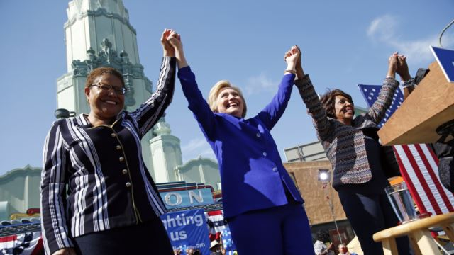 Democratic presidential candidate Hillary Clinton, center, celebrates at a rally with Rep. Karen Bass, D-Calif., left, and Rep. Maxine Waters, D-Calif., Monday, June 6, 2016.