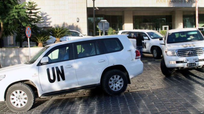 VOA FILE - A convoy of chemical weapons disarmament experts depart the Four Seasons Hotel in Damascus, Syria, Oct. 8, 2013. Activists say they have documented 18 cases of chlorine gas used in the country's rebel-held north since March 6, 2015.