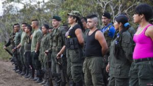 VOA FILE - Rebels of the Revolutionary Armed FOrces of Colombia, FARC, stand on formation at a camp.