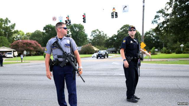 Police officers block off a road near the site of a shooting of police in Baton Rouge, Louisiana, July 17, 2016.
