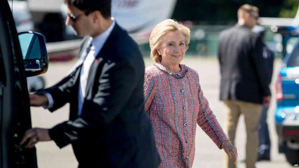 Democratic presidential candidate Hillary Clinton arrives to board her campaign plane at Westchester County Airport, in White Plains, Sept. 15, 2016, to travel to Greensboro, N.C. for a rally