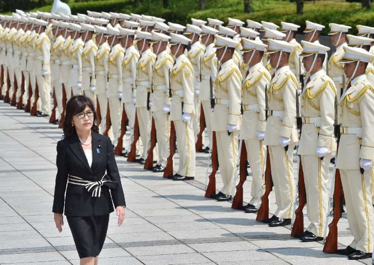 Tomoni Inada (L), a close confidante of Prime Minister Shinzo Abe with staunchly nationalist views, is Japan's newly appointed defence minister
