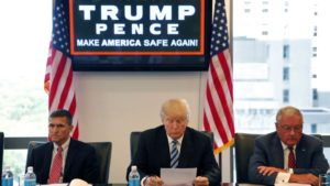 FILE - then-Republican presidential candidate Donald Trump participates in a roundtable discussion on national security in his offices in Trump Tower in New York.