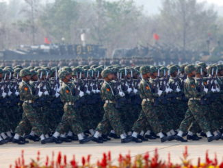 Soldiers parade to mark the 70th anniversary of Armed Forces Day in Myanmar's capital Naypyitaw, March 27, 2015. Myanmar's powerful army chief Min Aung Hlaing and his deputy are slated to extend their terms for another five years, a local newspaper said on February 13, 2016, as the military and democracy champion Aung San Suu Kyi negotiate the terms of transition.  Picture taken March 27, 2015. REUTERS/Soe Zeya Tun - RTX26XYV