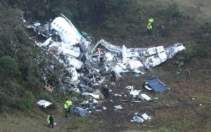 Police officers and rescue workers search for survivors around the wreckage Credit: Luis Benavides/AP Photo