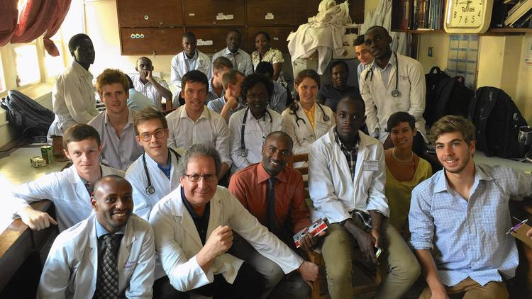 Dr. Sadigh's Tropical Medicine course with Ugandan colleagues, chief resident Dr. George, and Russian and international participants.