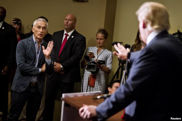 "FILE - Republican presidential candidate Donald Trump spars with Univision reporter Jorge Ramos before his ""Make America Great Again Rally"" at the Grand River Center in Dubuque, Iowa, Aug. 25, 2015."