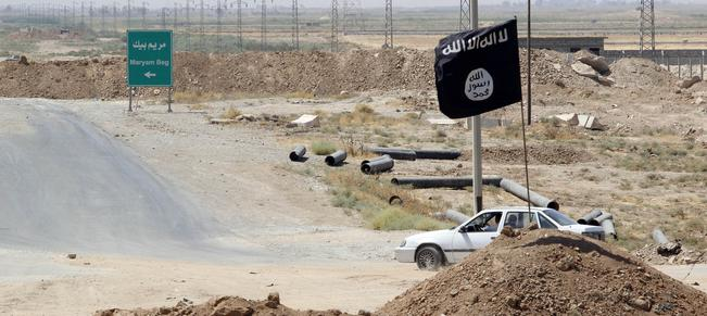 """Mandatory Credit: Photo by Xinhua News Agency/REX (4081672c) A flag of Islamic State is seen on the """"border"""" of the Islamic State militants and Kurdish fighters on the road to Tikrit Kurdish fighters on the frontline in Kirkuk, Iraq - 24 Aug 2014"""