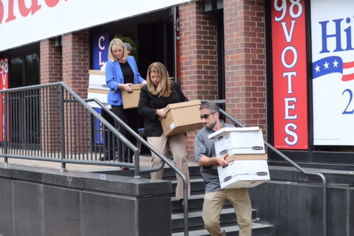 """FBI employees carry out boxes from the offices of the International Brotherhood of Electrical Workers Local 98 in Philadelphia on Friday, Aug. 5, 2016. About 100 boxes - with some labeled """"bank statements"""" and """"taxes"""" - were loaded into a rental truck along with four computers."""