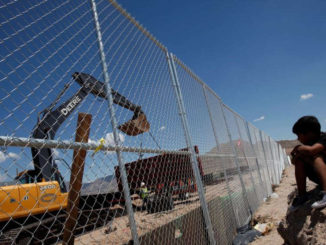 A child looks at U.S. workers building a section of the U.S.-Mexico border wall at Sunland Park, U.S. opposite the Mexican border city of Ciudad Juarez, Mexico, Aug. 26, 2016. Picture taken from the Mexico side of the U.S.-Mexico border
