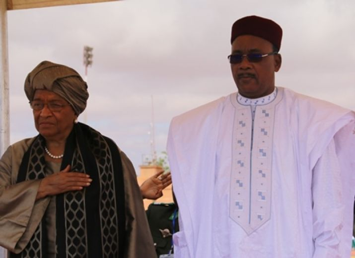 Presidents Sirleaf and Mahamadou at attention as both countries National Anthem played