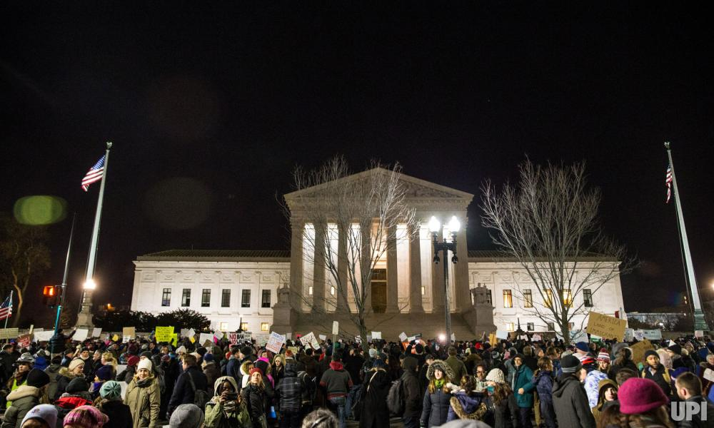 Demonstrators participate in a candlelight vigil in front of the U.S. Supreme Court in Washington, D.C., on January 30, 2017, to call on President Trump to reverse his administration's recent anti-refugee and anti-immigrant executive orders which bans people traveling from Iraq, Iran, Sudan, Syria, Yemen, Libya and Somalia from entering the United States for 90 days. Photo by Erin Schaff/UPI