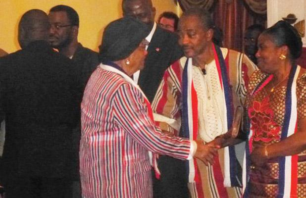 Rev. J. Emmanuel Bowier; 2016 Flag Day Orator in a chat with President Sirleaf at the program,