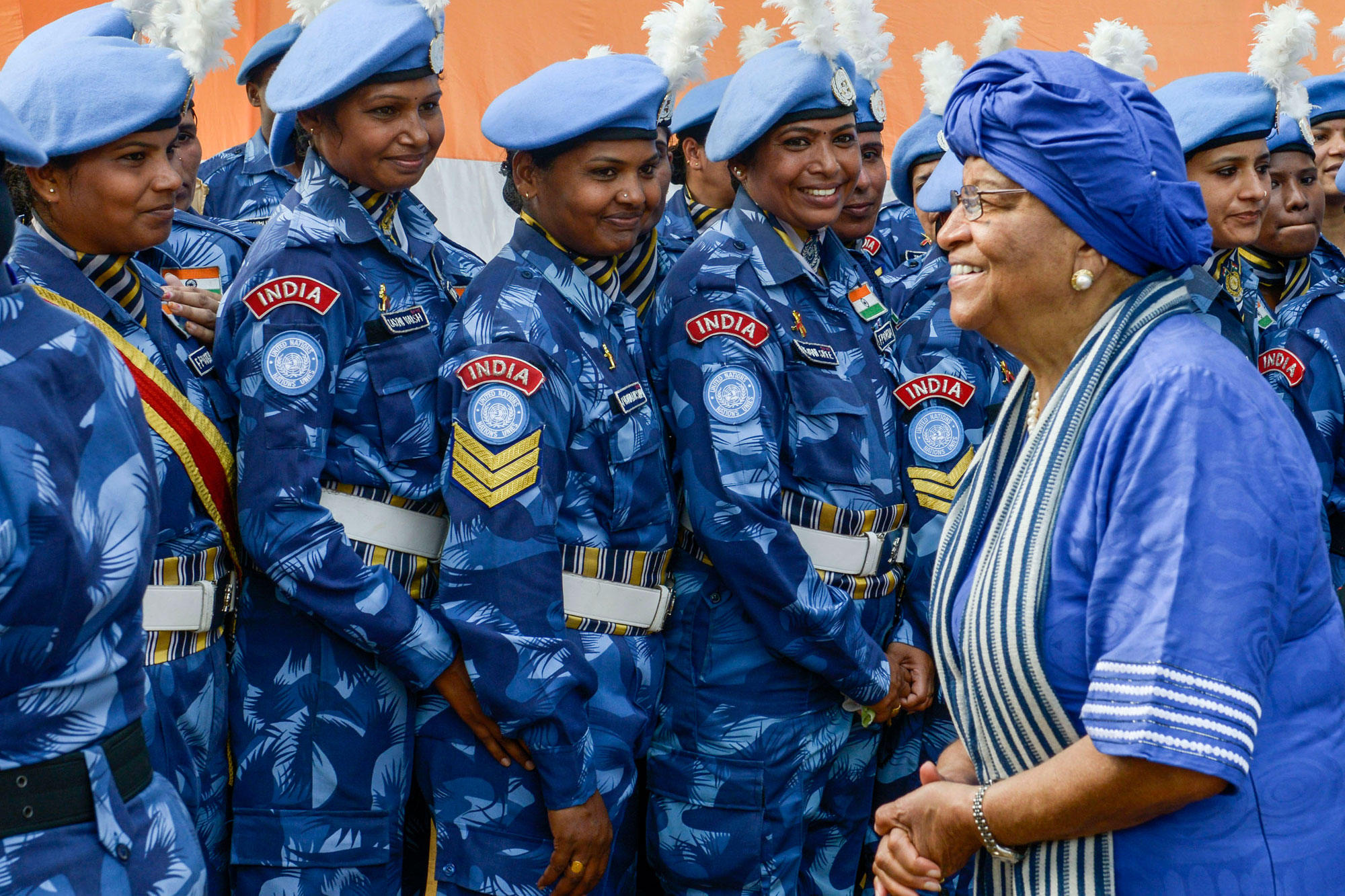 [President Ellen Johnson-Sirleaf (left) with members of the all-female Indian Formed Police Unit serving with the UN Mission in Liberia in February 2016. Photo: Emmanuel Tobey/UNMIL]