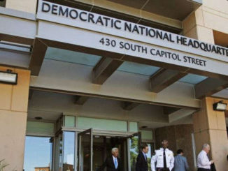 FILE - People stand outside the Democratic National Committee (DNC)