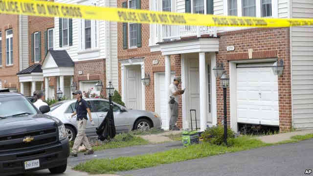 Law enforcement officers are seen outside the home of Nicholas Young, a Washington Metro Transit Officer, Aug. 3, 2016, in Fairfax, Virginia/Credit: VOA News.