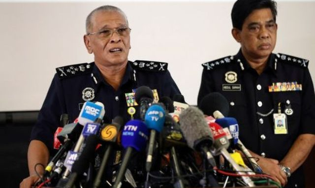Malaysia Deputy Inspector-General of Police Noor Rashid Ibrahim, left, speaks during a press conference at police headquarters in Kuala Lumpur, Malaysia, Sunday, Feb. 19, 2017. Investigators are still trying to piece together details of what appears to be the brazen assassination of Kim Jong Nam, the half brother of North Korea's mercurial ruler and an exiled member of the country's elite.(Photo: Vincent Thian, AP)Kim-Jong-Nam-press-conference-Photo Credit: AP