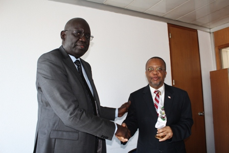 Ambassador Abdou Sourang in handshake with Ambassador C. William Allen