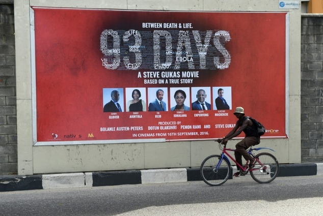 "A man cycles past a billboard in Lagos promoting the premier of Nollywood film ""93 Days"" dramatizes Nigeria's response to the Ebola epidemic in 2014 ©Pius Utomi Ekpei (AFP)"