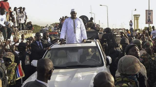 A photo made available 27 January 2017 of Gambia's new president Adama Barrow standing in a car while being cheered by supporters as he arrives from the airport in Banjul, Gambia, 26 January 2017. GAMBIA CRISIS