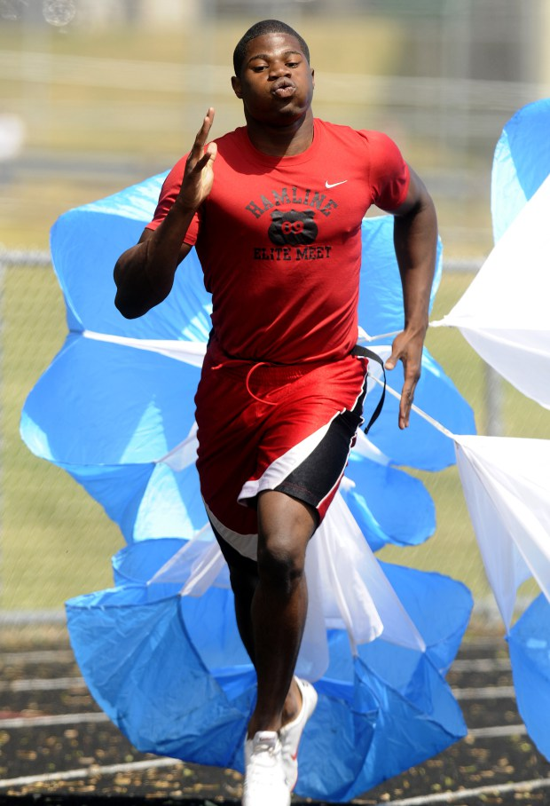 Emmanuel Matadi of Johnson H.S. in St. Paul ran 250 meter repeats with parachutes  on the track behind his school on Monday, June 1, 2009, as he gets ready for the state meet.  (Pioneer Press: Scott Takushi)