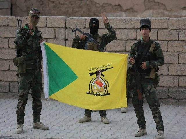 fighters-hold-hezbollah-flag-afp-640x480