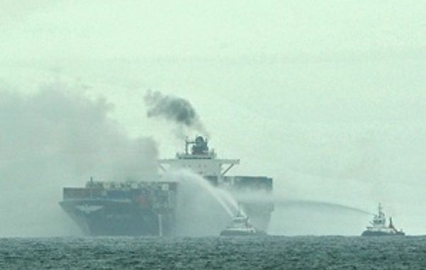 A harbour tug provided boundary cooling to the APL Austria that caught fire off the Eastern Cape coast. (Werner Hills, Netwerk24)