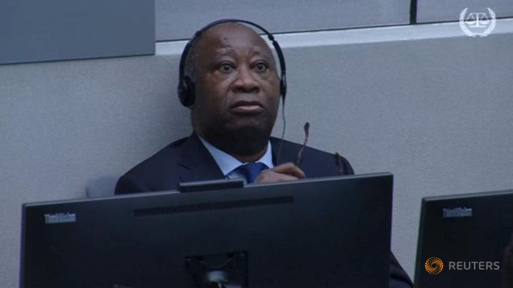 Former Ivory Coast's President Laurent Gbagbo attends his trial on charges of unleashing a civil war, in The Hague i