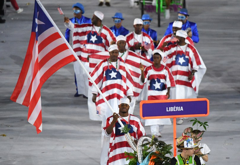 Liberia's flagbearer Emmanuel Matadi leads his delegation during the opening ceremony of the Rio 2016 Olympic Games at the Maracana stadium in Rio de Janeiro on August 5, 2016. / AFP / PEDRO UGARTE (Photo credit should read PEDRO UGARTE/AFP/Getty Images)