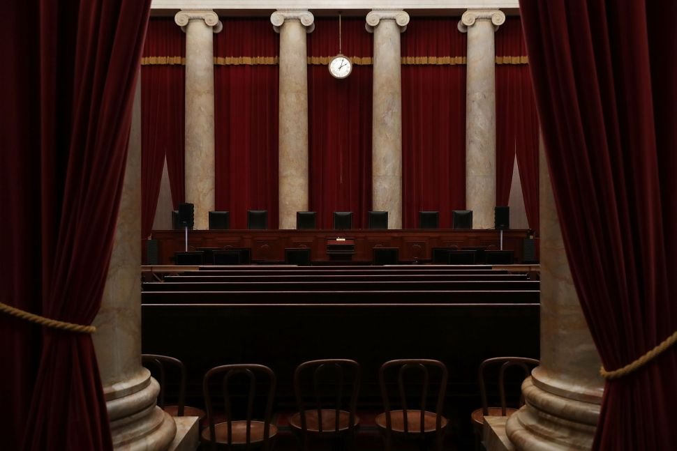 WASHINGTON, DC - SEPTEMBER 30:  The courtroom of he U.S. Supreme Court  is seen September 30, 2016 in Washington, DC. The Supreme Court will return for a new term on Monday, October 3.  (Photo by Alex Wong/Getty Images)