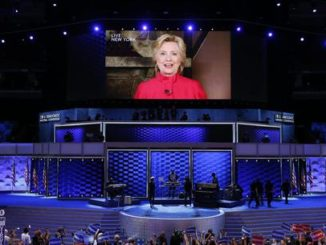 Democratic Presidential Nominee Hillary Clinton is seen displayed in a screen as she delivers remarks in the Wells Fargo Center on day 2 of the 2016 Democratic National Convention (DNC) in Philadelphia, Pennsylvania, USA, 26 July 2016. The four-day convention is expected to end with Hillary Clinton formally accepting the nomination of the Democratic Party as their presidential candidate in the 2016 election.  EPA/SHAWN THEW