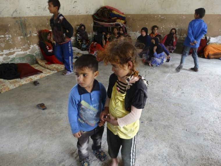 Children and other Iraqis displaced from their homes by ISIS militants fidn refuge in a school in the city of Ramadi, Iraq.