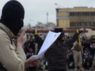 An ISIS fighter reading out the execution order pronounced by Sharia court in Iraq. File Photo