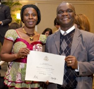 FRIEND OF THE MEDIA: Melissa Chea- Annan proudly displays her certificate by her side is Liberian journalist and 2006-07 Humphrey Fellow James Dorbor Jallah
