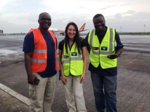 FLASH BACK: CHAI Liberia Deputy Country Director Lauren Zinner awaiting the largest individual donation of supplies to the Ebola response, September 2014, with Mr. James Dorbor Jallah and Deputy Minister Tolbert Nyenswah, two leaders within the national Ebola response