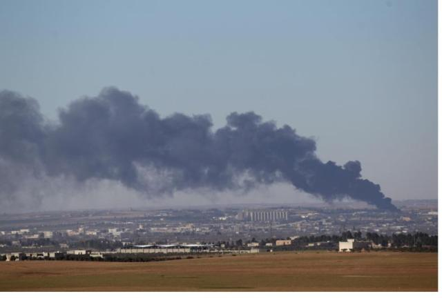 Smoke rises from the northern Syrian town of al-Bab, Syria February 2, 2017. REUTERS/Khalil Ashawi