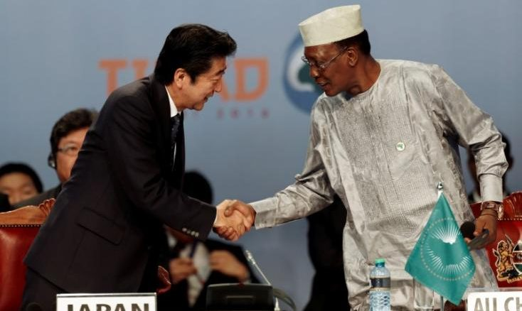 Japan's Prime Minister Shinzo Abe (L) greets Chairperson of the African Union (AU) and Chad's President Idriss Deby as they attend Sixth Tokyo International Conference on African Development (TICAD VI), in Kenya's capital Nairobi, August 27, 2016. REUTERS/Thomas Mukoya - RTX2N8M3