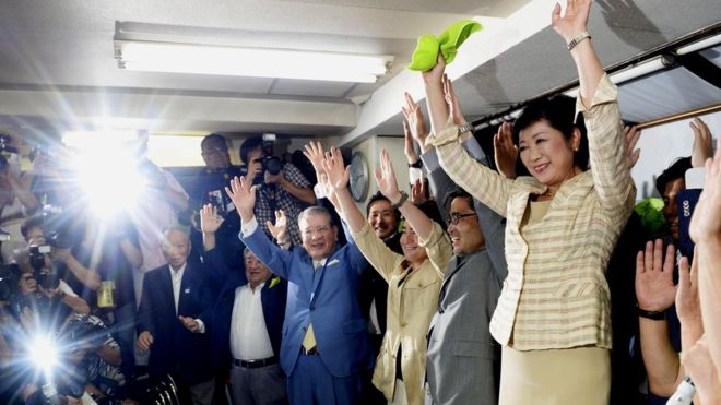 Yuriko Koike, right, celebrated with supporters after exit polls predicted her election victory