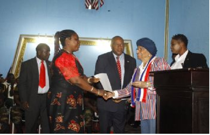 Liberian leader certificating one of the winners