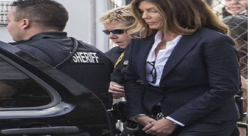Kathleen G. Kane is led out of the Montgomery County Courthouse in handcuffs by sheriff's deputies